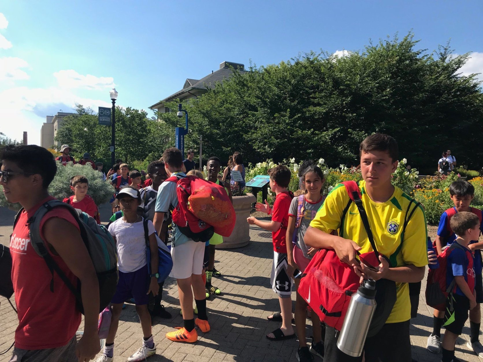 Attendees of a Wizards basketball camp head to meet their parents after the end of the lockdown. (WTOP/Dick Uliano)