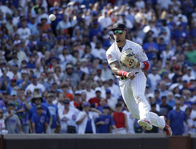 Chicago Cubs' Javier Baez throws out Detroit Tigers' Jose Iglesias to end a baseball game Tuesday, July 3, 2018, in Chicago. The Cubs won 5-3. (AP Photo/Charles Rex Arbogast)