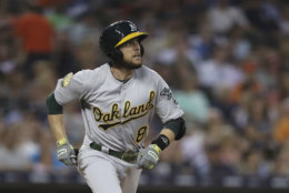 Oakland Athletics' Jed Lowrie watches his solo home run during the fifth inning against the Detroit Tigers in a baseball game Tuesday, June 26, 2018, in Detroit. (AP Photo/Carlos Osorio)