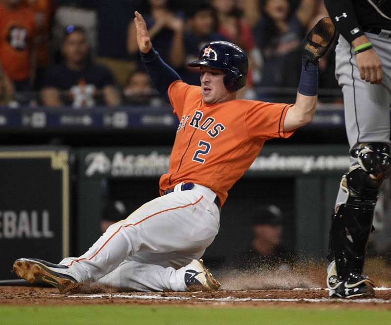 Houston Astros' Alex Bregman, left, scores during the third inning of the team's baseball game against the Chicago White Sox, Friday, July 6, 2018, in Houston. (AP Photo/Eric Christian Smith)