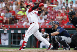 Cincinnati Reds' Eugenio Suarez watches his RBI double off Milwaukee Brewers starting pitcher Junior Guerra during the first inning of a baseball game Thursday, June 28, 2018, in Cincinnati. (AP Photo/John Minchillo)
