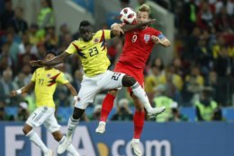 Colombia's Davinson Sanchez, left, and England's Harry Kane challenge for the ball during the round of 16 match between Colombia and England at the 2018 soccer World Cup in the Spartak Stadium, in Moscow, Russia, Tuesday, July 3, 2018. (AP Photo/Alastair Grant)