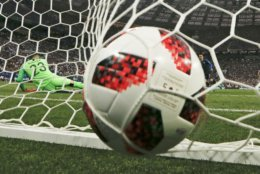 Croatia goalkeeper Danijel Subasic fails to stop France's Antoine Griezmann from scoring from the penalty spot his side's second goal during the final match between France and Croatia at the 2018 soccer World Cup in the Luzhniki Stadium in Moscow, Russia, Sunday, July 15, 2018. (AP Photo/Natacha Pisarenko)