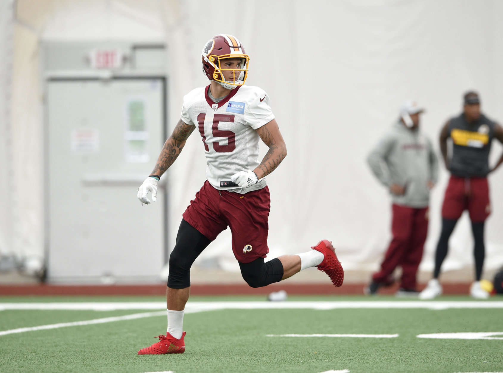 Washington Redskins wide receiver Simmie Cobbs (15) runs a pass route during an NFL football team practice, Wednesday, June 13, 2018, in Ashburn, Va. (AP Photo/Nick Wass)