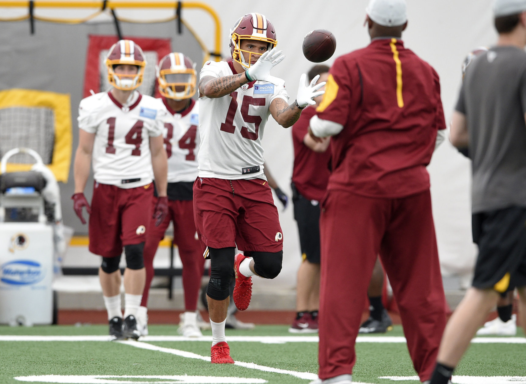 Washington Redskins wide receiver Simmie Cobbs (15) runs a drill during an NFL football team practice, Wednesday, June 13, 2018, in Ashburn, Va. (AP Photo/Nick Wass)