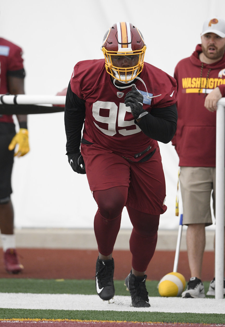 Washington Redskins defensive tackle Daron Payne (95) runs a drill during an NFL football team practice, Wednesday, June 13, 2018, in Ashburn, Va. (AP Photo/Nick Wass)