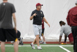 Washington Redskins head coach Jay Gruden gestures during an NFL football team practice, Wednesday, June 13, 2018, in Ashburn, Va. (AP Photo/Nick Wass)
