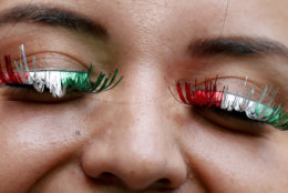 A supporter of Mexico arrives for the round of 16 match between Brazil and Mexico at the 2018 soccer World Cup in the Samara Arena, in Samara, Russia, Monday, July 2, 2018. (AP Photo/Frank Augstein)