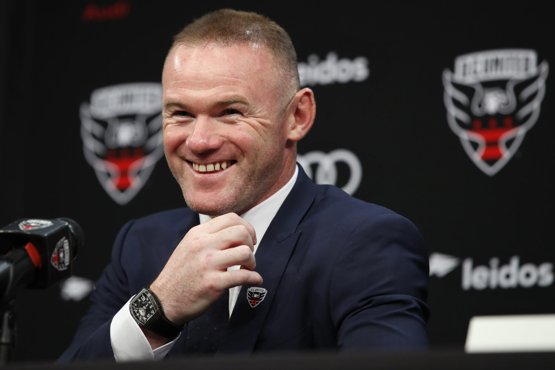 English soccer star Wayne Rooney, the all-time leading scorer for England's national team and Manchester United in the Premier League, smiles during a news conference announcing his signing with MLS team D.C. United, Monday, July 2, 2018, at the Newseum in Washington. (AP Photo/Jacquelyn Martin)