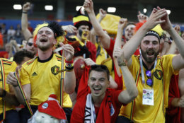 Belgium's fans celebrate their team victory over Japan during the round of 16 match between Belgium and Japan at the 2018 soccer World Cup in the Rostov Arena, in Rostov-on-Don, Russia, Monday, July 2, 2018. (AP Photo/Rebecca Blackwell)