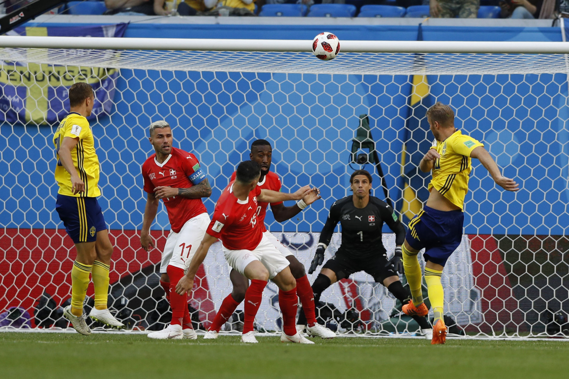 Sweden's Ola Toivonen, right, takes a shot during the round of 16 match between Switzerland and Sweden at the 2018 soccer World Cup in the St. Petersburg Stadium, in St. Petersburg, Russia, Tuesday, July 3, 2018. (AP Photo/Darko Bandic)