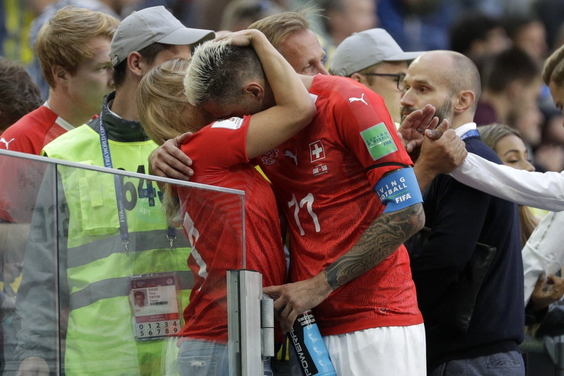 Switzerland's Valon Behrami hugs a woman after the round of 16 match between Switzerland and Sweden at the 2018 soccer World Cup in the St. Petersburg Stadium, in St. Petersburg, Russia, Tuesday, July 3, 2018. Sweden won 1-0. (AP Photo/Gregorio Borgia)