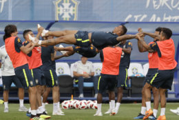 Brazil's players stretch teammate Danilo during a training session, in Sochi, Russia, Tuesday, July 3, 2018. Brazil will face Belgium on July 6 in the quarterfinals for the soccer World Cup. (AP Photo/Andre Penner)