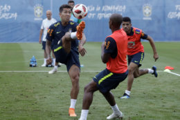 Brazil's Roberto Firmino, left, Fernandinho, center, and Taison practice during a training session, in Sochi, Russia, Tuesday, July 3, 2018. Brazil will face Belgium on July 6 in the quarterfinals for the soccer World Cup. (AP Photo/Andre Penner)