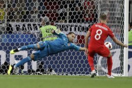 Colombia goalkeeper David Ospina saves a penalty during the round of 16 match between Colombia and England at the 2018 soccer World Cup in the Spartak Stadium, in Moscow, Russia, Tuesday, July 3, 2018. (AP Photo/Matthias Schrader)
