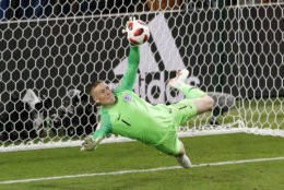 England goalkeeper Jordan Pickford stops a penalty shot from Colombia's Carlos Bacca during the round of 16 match between Colombia and England at the 2018 soccer World Cup in the Spartak Stadium, in Moscow, Russia, Tuesday, July 3, 2018. (AP Photo/Antonio Calanni)