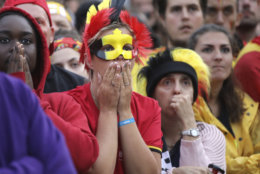 Belgium fans react as they watch a 2018 World Cup semifinal soccer match between France and Belgium on a giant screen in Jette, Belgium, Tuesday, July 10, 2018. (AP Photo/Olivier Matthys)