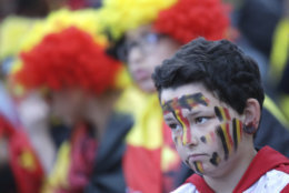 A Belgium fan reacts as he watches a 2018 World Cup semifinal soccer match between France and Belgium on a giant screen in Jette, Belgium, Tuesday, July 10, 2018. (AP Photo/Olivier Matthys)
