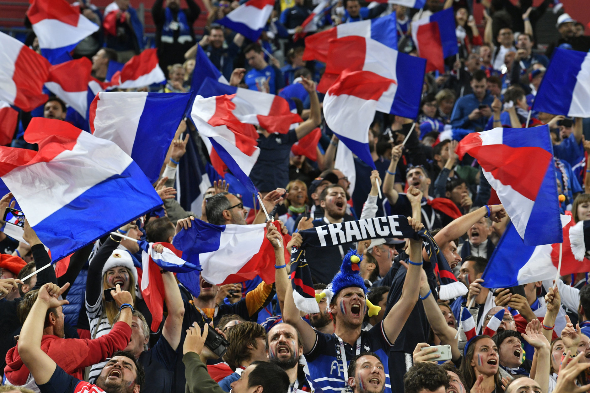 France supporter cheer after their team advanced to the final during the semifinal match between France and Belgium at the 2018 soccer World Cup in the St. Petersburg Stadium in St. Petersburg, Russia, Tuesday, July 10, 2018. (AP Photo/Martin Meissner)