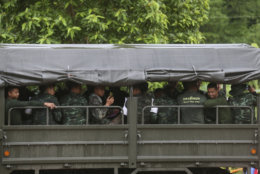 Thai soldiers leave a cave rescue area in Mae Sai, Chiang Rai province, northern Thailand, Wednesday, July 11, 2018. A daring rescue mission in the treacherous confines of a flooded cave in northern Thailand has saved all 12 boys and their soccer coach who were trapped deep within the labyrinth, ending a grueling 18-day ordeal that claimed the life of an experienced volunteer diver and riveted people around the world. (AP Photo/Sakchai Lalit)