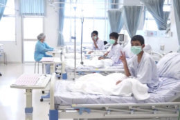 In this image made from video, released by the Thailand Government Spokesman Bureau, three of the 12 boys are seen recovering in their hospital beds after being rescued along with their coach from a flooded cave in Mae Sai, Chiang Rai province, northern Thailand. (Thailand Government Spokesman Bureau via AP)