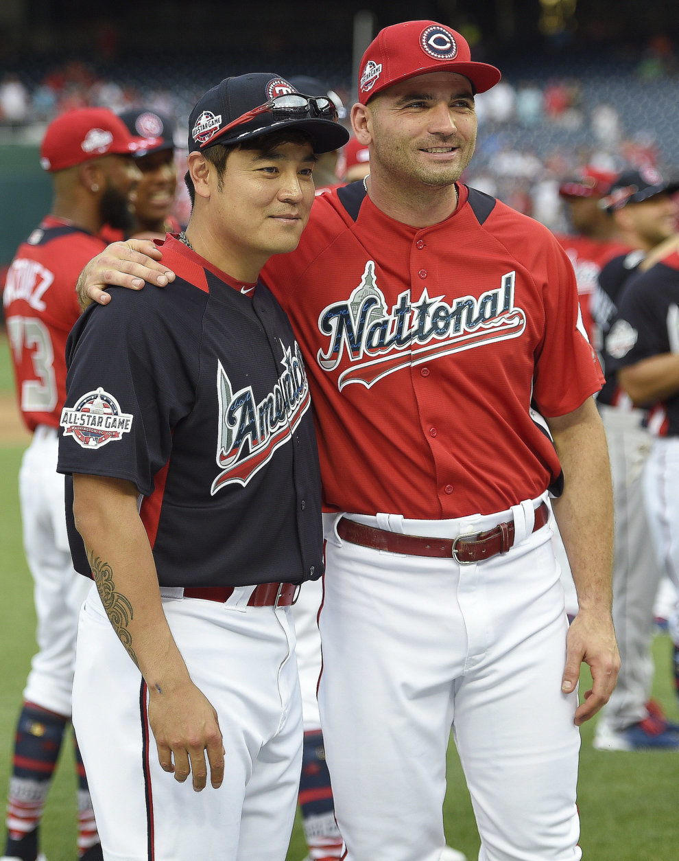 National League, Colorado Rockies Charlie Blackmon, right, embraces American League, Texas Rangers outfielder Shin-Soo Choo ahead of the All-Star Home Run Derby Baseball event, Monday, July 16, 2018, at Nationals Park, in Washington. The 89th MLB baseball All-Star Game will be played Tuesday. (AP Photo/Nick Wass)