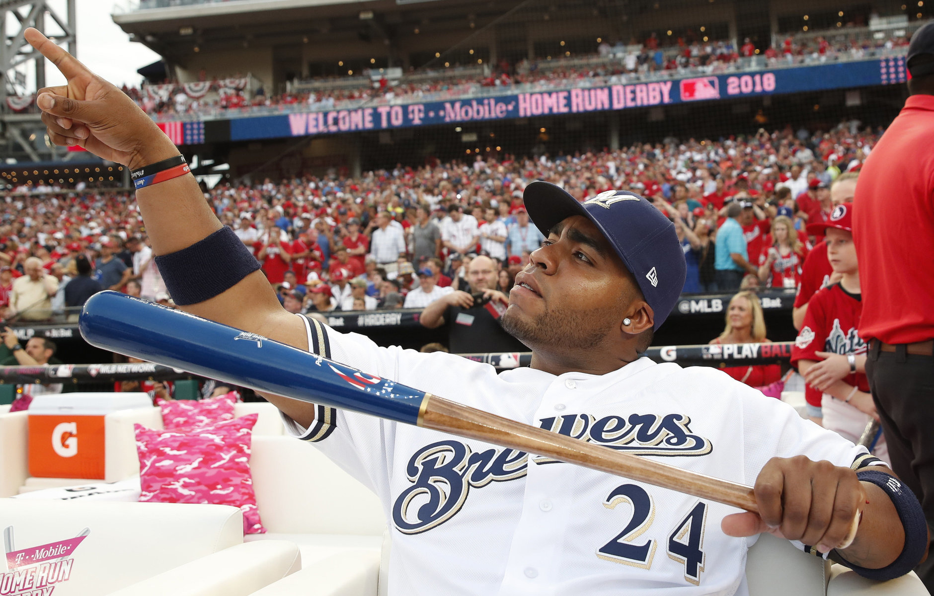 Milwaukee Brewers Jesús Aguilar (24) points toward the outfield before the MLB Home Run Derby, at Nationals Park, Monday, July 16, 2018 in Washington. The 89th MLB baseball All-Star Game will be played Tuesday. (AP Photo/Alex Brandon)