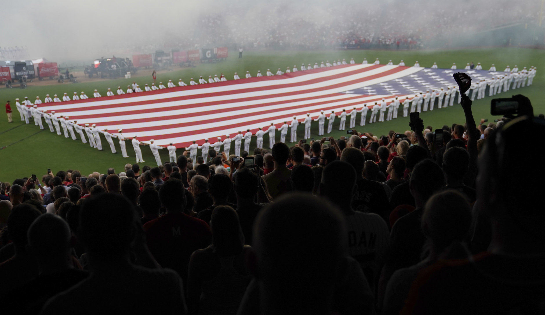 U.S. Navy sailors unfurl a flag before the MLB Home Run Derby, at Nationals Park, Monday, July 16, 2018 in Washington. The 89th MLB baseball All-Star Game will be played Tuesday. (AP Photo/Carolyn Kaster)