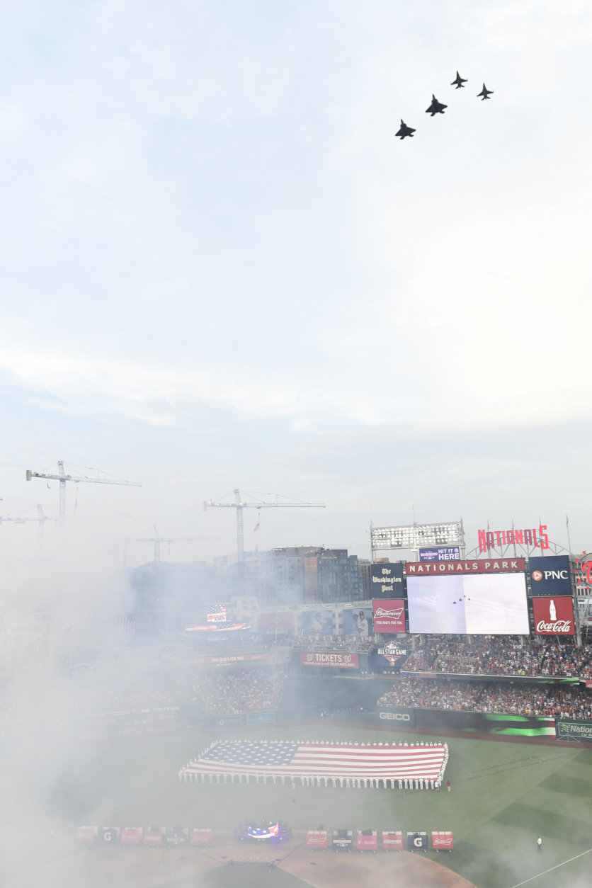 U.S. military aircraft flyover the stadium before the MLB Home Run Derby, at Nationals Park, Monday, July 16, 2018 in Washington. The 89th MLB baseball All-Star Game will be played Tuesday. (AP Photo/Susan Walsh)