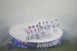 MLB players line up before the MLB Home Run Derby, at Nationals Park, Monday, July 16, 2018 in Washington. The 89th MLB baseball All-Star Game will be played Tuesday. (AP Photo/Nick Wass)