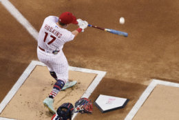 Philadelphia Phillies Rhys Hoskins (17) bats during the MLB Home Run Derby, at Nationals Park, Monday, July 16, 2018 in Washington. The 89th MLB baseball All-Star Game will be played Tuesday. (AP Photo/Susan Walsh)