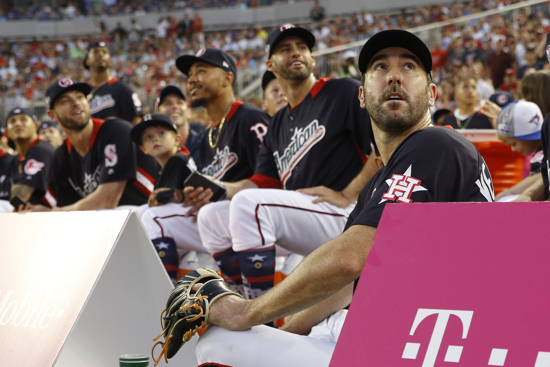 American League, Boston Red Sox pitcher Justin Verlander, right, watches play during the MLB Home Run Derby, at Nationals Park, Monday, July 16, 2018 in Washington. The 89th MLB baseball All-Star Game will be played Tuesday. (AP Photo/Patrick Semansky)