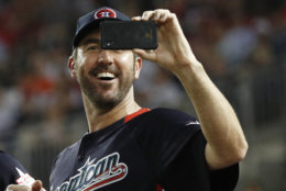 American League, Boston Red Sox pitcher Justin Verlander (35) shoots pictures during the MLB Home Run Derby, at Nationals Park, Monday, July 16, 2018 in Washington. The 89th MLB baseball All-Star Game will be played Tuesday. (AP Photo/Patrick Semansky)