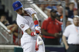 Chicago Cubs Javier Báez (9) hits during the MLB Home Run Derby, at Nationals Park, Monday, July 16, 2018 in Washington. The 89th MLB baseball All-Star Game will be played Tuesday. (AP Photo/Alex Brandon)
