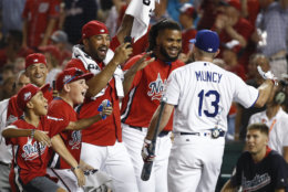 Los Angeles Dodgers Max Muncy (13) is congratulated by his National League teammates during the MLB Home Run Derby, at Nationals Park, Monday, July 16, 2018 in Washington. The 89th MLB baseball All-Star Game will be played Tuesday. (AP Photo/Patrick Semansky)