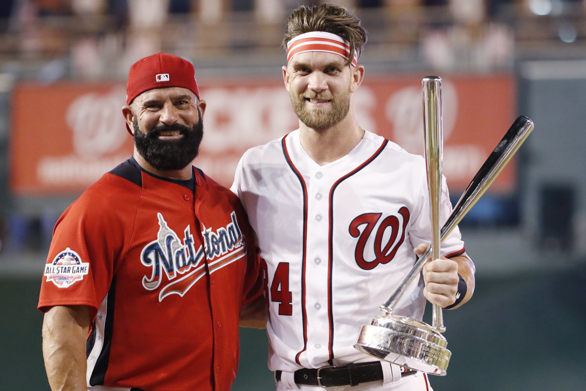 Washington Nationals Bryce Harper stands with his father Ron Harper after Bryce won the Major League Baseball Home Run Derby, Monday, July 16, 2018 in Washington. The 89th MLB baseball All-Star Game will be played Tuesday. (AP Photo/Alex Brandon)