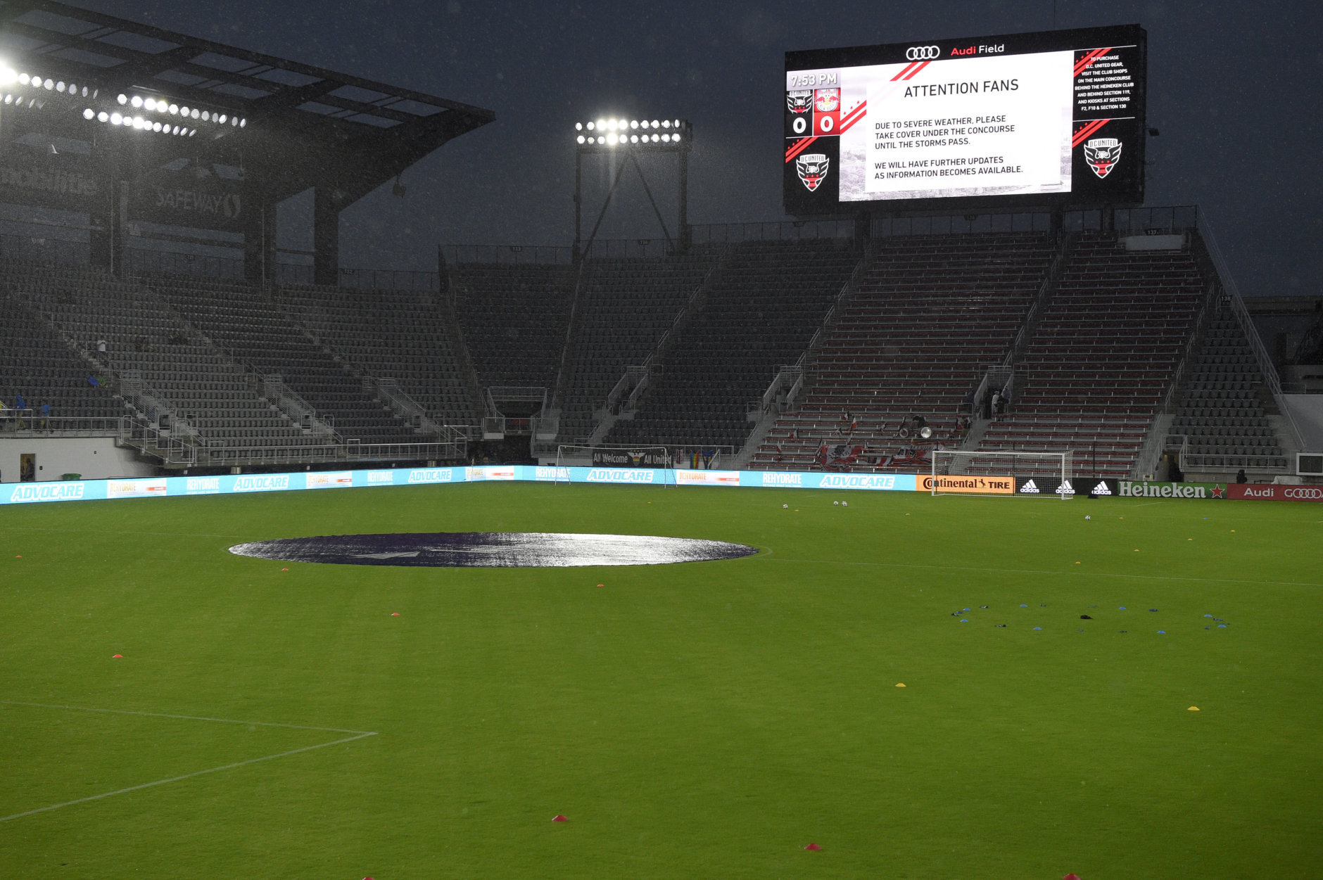 A sign on the scoreboard tells of severe weather which delayed the start of the MLS soccer match between D.C. United and the New York Red Bulls, Wednesday, July 25, 2018, in Washington. (AP Photo/Nick Wass)