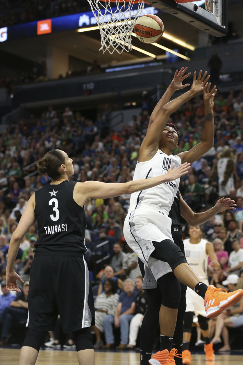 Team Candace Parker's Angel McCoughtry (35) tries to rebound the ball against Team Delle Donne's Diana Taurasi (3) in the first half of the WNBA All-Star basketball game Saturday, July 28, 2018 in Minneapolis. (AP Photo/Stacy Bengs)