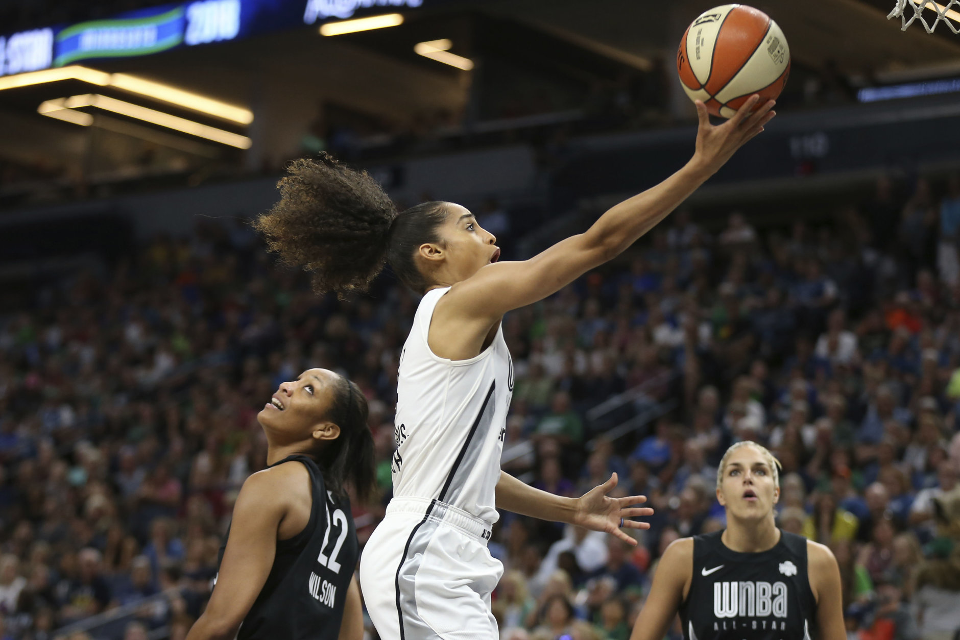 Team Candace Parker's Skylar Diggins-Smith, center, goes to the basket against Team Delle Donne's A'ja Wilson (22) in the first half of the WNBA All-Star basketball game Saturday, July 28, 2018 in Minneapolis. (AP Photo/Stacy Bengs)