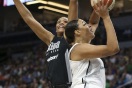 Team Candace Parker's Liz Cambage, right, shoots the ball against Team Delle Donne's A'ja Wilson, left, in the first half of the WNBA All-Star basketball game Saturday, July 28, 2018 in Minneapolis. (AP Photo/Stacy Bengs)