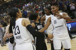 Team Candace Parker's Maya Moore, left, and Angel McCoughtry, right, celebrate after their team won 119-112 against Team Delle Donne in the WNBA All-Star basketball game Saturday, July 28, 2018 in Minneapolis. (AP Photo/Stacy Bengs)