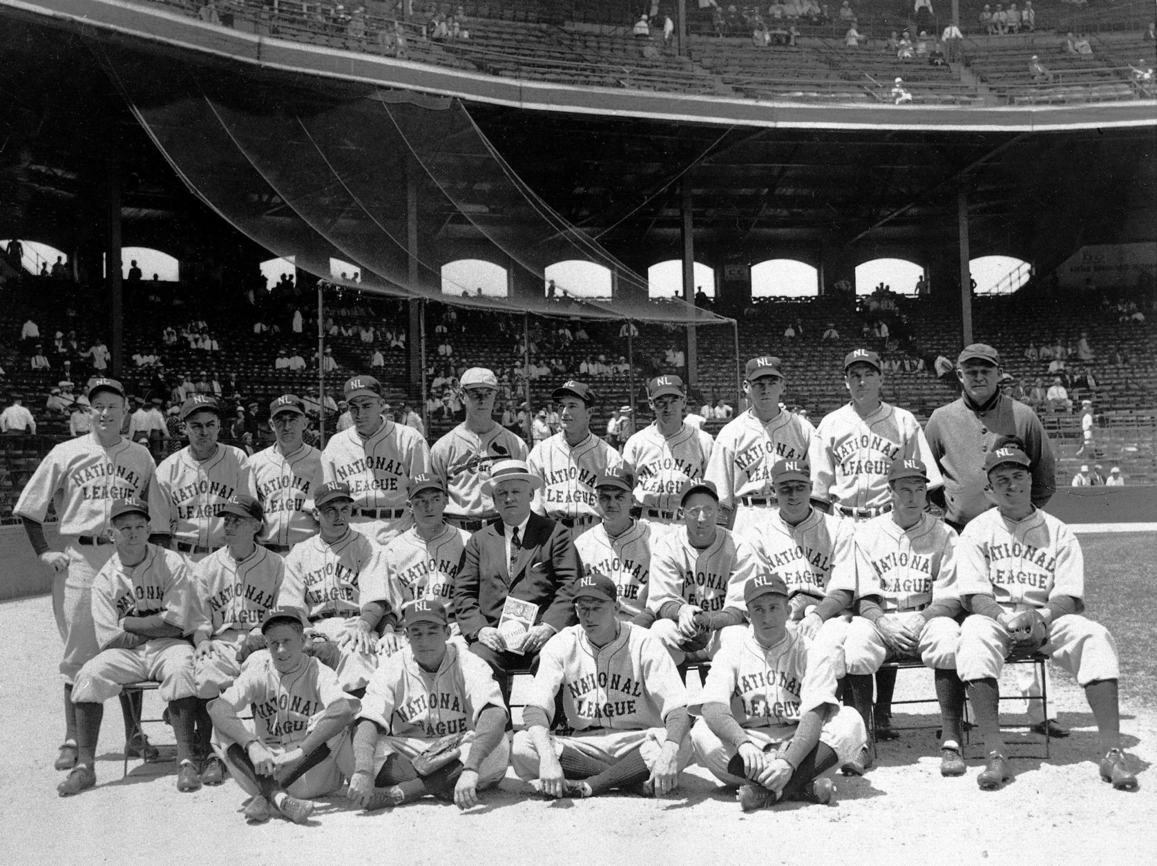 The National League team poses before the first major league All-Star Game in Chicago, Ill., on July 6, 1933.  The American League won 4-2.  Front row, from left: bat boy Hasbrook, Pepper Martin, Lon Warneke, Tony Cuccinello.  Middle row, from left: Bill Hallahan, Dick Bartell, Bill Terry, Bill McKechnie, John McGraw, Max Carey, Chick Hafey, Chuck Klein, Lefty O'Doul, Wally Berger.  Back row, from left: Gabby Hartnett, Hack Wilson, Frankie Frisch, Carl Hubbell, Bill Walker, Paul Warner, Woody English, Hal Schumacher, Pie Traynor, trainer Andy Lotshaw.  (AP Photo)
