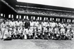 The American League team poses before the first major league All-Star Game in Chicago, July, 6, 1933.  The American League won 4-2.  Front row, from left: Al Schact, Eddie Collins, Tony Lazzeri, General Crowder, Foxx Fletcher, Earl Averill, Ed Rommel, Ben Chapman, Rick Ferrell, Sam West, Charlie Gehringer, bat boy.  Back row, from left: bat boy, unidentified team member, Lou Gehrig, Babe Ruth, Oral Hildebrand, Connie Mack, Joe Cronin, Lefty grove, bat boy, Bill Dickey, Al Simmons, Lefty Gomez, Wes Ferrell, Jimmy Dykes, club boy. (AP Photo)