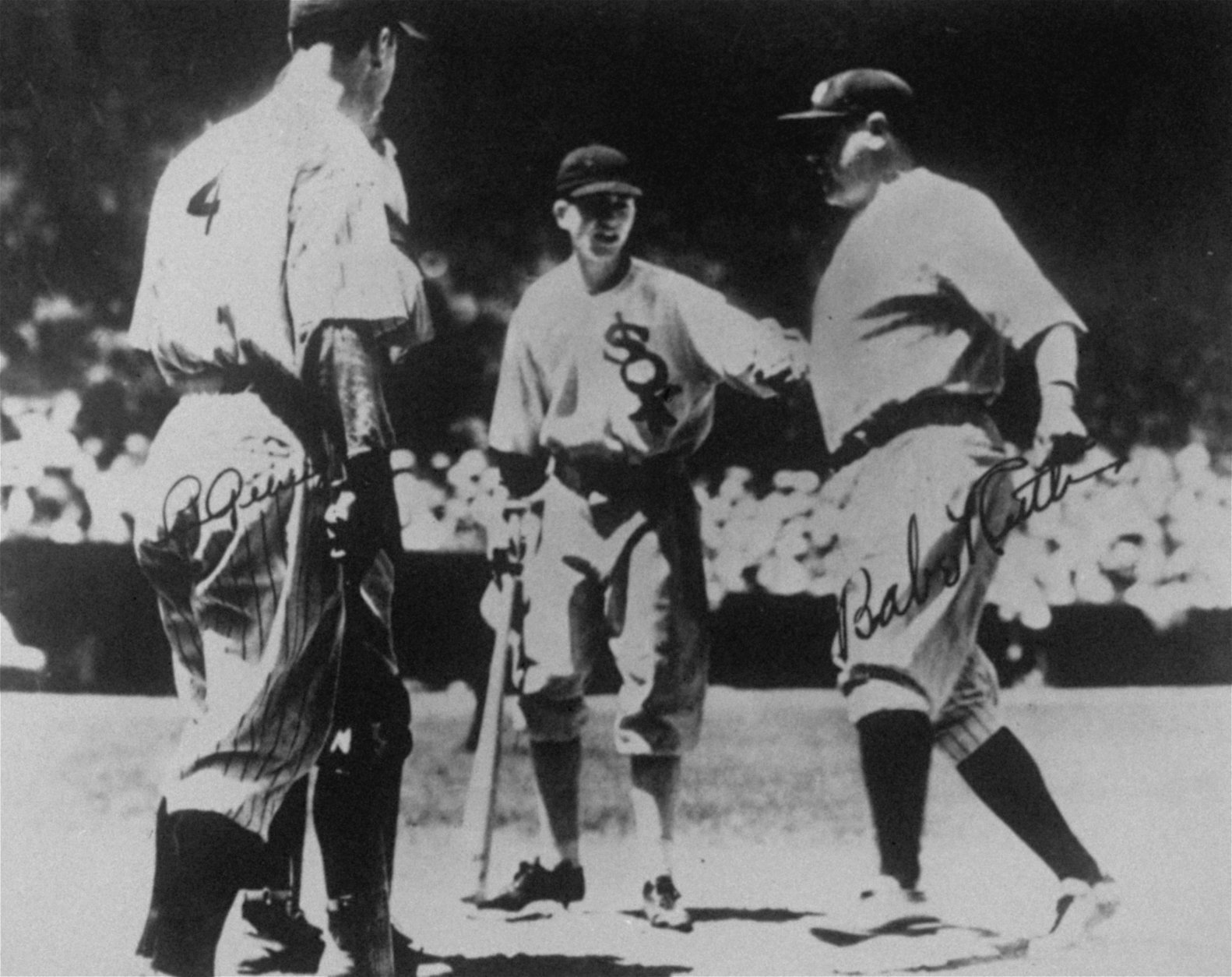 Babe Ruth crosses home plate following a two run home run off National League starting pitcher Bill Hallahan in the third inning of the first All-Star Game ever played, July 6, 1933.  Greeting Ruth at home plate are, from left:  Yankee teammate, Lou Gehrig and White Sox bat boy, John McBride.  Barely visible behind Gehrig is National League catcher Jimmie Wilson.  The American League won 4-2. (AP Photo)
