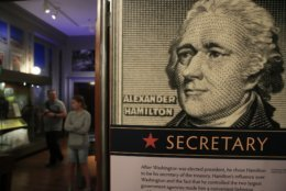 "FILE - This June 11, 2018 file photo shows an Alexander Hamilton exhibit called ""Alexander Hamilton: Soldier, Secretary, Icon,"" that includes mail, portraits, and postage and revenue stamps reflective of Hamilton's life and career, at Smithsonian National Postal Museum in Washington. The West Indies-born immigrant Hamilton volunteered for the Continental Army. The young Hamilton caught the eye of Washington and became a trusted adviser, helping defeat the British in the Battle of Yorktown. (AP Photo/Manuel Balce Ceneta, File)"