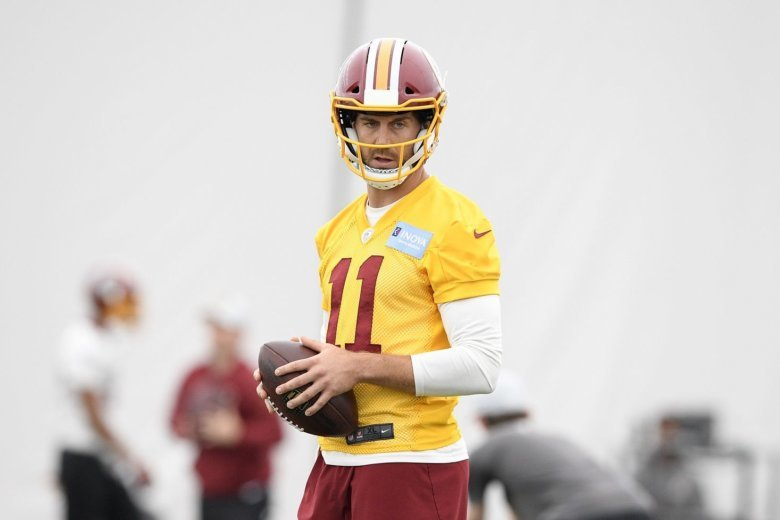 32a1f5c6771 Washington Redskins quarterback Alex Smith holds the ball during an NFL  football team practice, Wednesday, June 13, 2018, in Ashburn, Va. (AP.