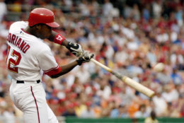 Washington Nationals' Alfonso Soriano hits a solo home run against the San Diego Padres during the first inning of a baseball game Saturday, July 8, 2006 in Washington.(AP Photo/Nick Wass)