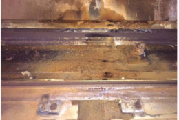 On the Yellow Line from Huntington to Eisenhower Ave, the side wall tunnel leaks onto third rail and running rail causing rusting. (Courtesy FTA)