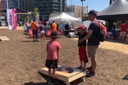 The Play Ball Park across from Nationals Stadium features activities like cornhole all weekend long. (WTOP/Melissa Howell)
