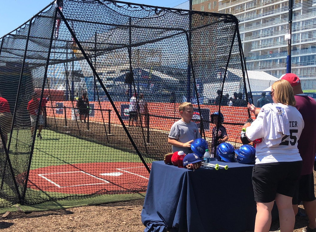 The Play Ball Park across from Nationals Stadium features batting cages for everyone to try to hit pitches. (WTOP/Melissa Howell)